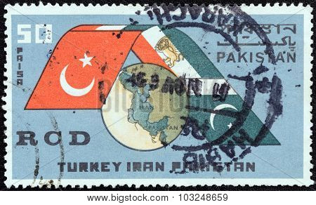 PAKISTAN - CIRCA 1965: Stamp shows Globe and flags of Turkey, Iran and Pakistan
