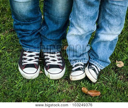 blue jeans and black and white shoes adult and child