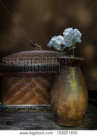 Vase Of Flowers And A Basket.