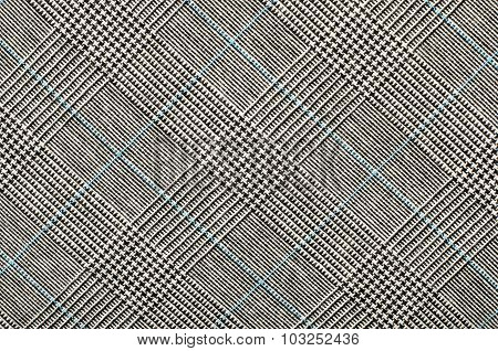 Black And White With Blue Houndstooth Pattern In Squares.