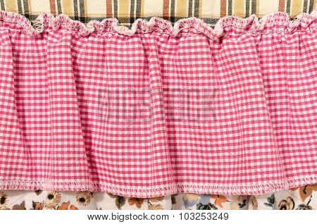 Close Up On Checkered Tablecloth Fabric On A Curtain.