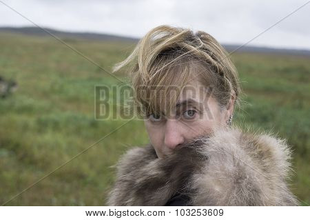 Woman Wrapped Up In Coat