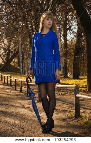 Pretty Blonde In Autumn Park