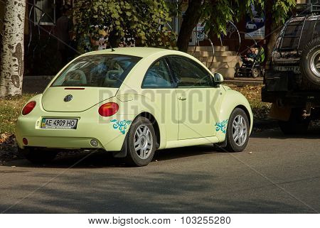 Light Green Volkswagen New Beetle Car Parked In A Street Of The City Centre.
