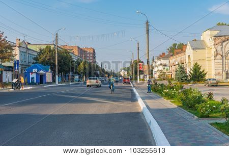 Landscape with central street of the small city Okhtyrka at autumnal weekend
