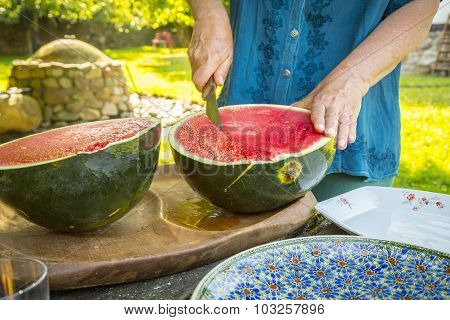Close Up Of A Men Who Is Cutting A Water Melon