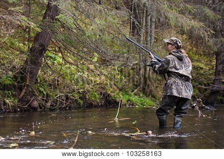 Woman Hunter Shooting On The River
