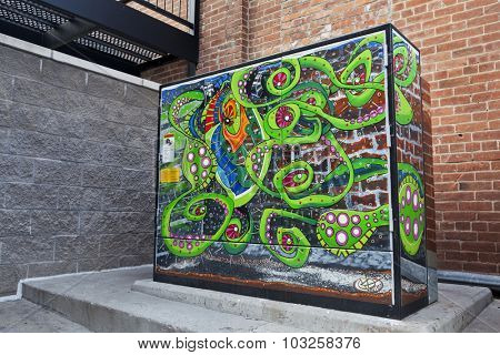 FORT COLLINS, CO, USA, JULY 17, 2012: Transformer cabinet turned into fish tank - alien octopus mural in the Old Town of Fort Collins, Colorado, Artist - Keith VanEron.