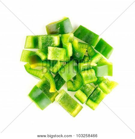 Isolated Aerial Of Green Capsicum Chopped Up Into Pieces