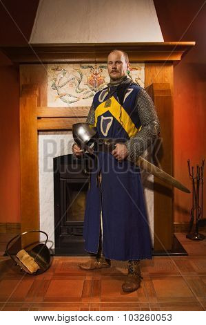 Knight With Sword Against Fireplace