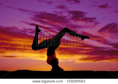 Silhouette Of Woman Legs Apart Doing Head Stand