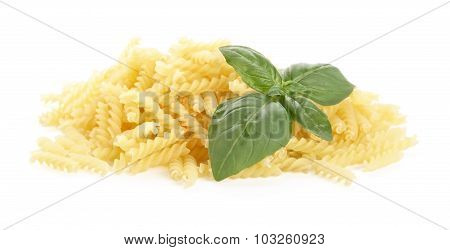 Many Fusilli Pasta With Basil Leaves Isolated On White