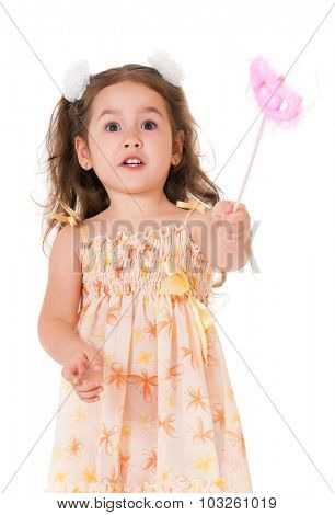 Beautiful little girl with magic wand, isolated on white background