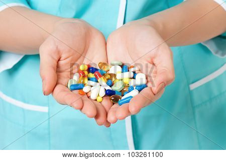 Close up of pills in woman hands