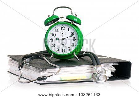 Stethoscope, alarm clock and file folder, isolated on white background