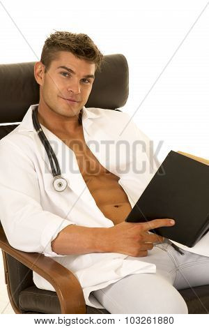 Doctor With Open Jacket With Book Sitting Look