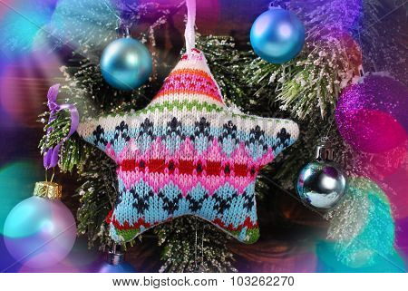 Knitted Star Decoration On Christmas Tree