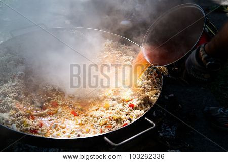 Preparing Paella With Broth