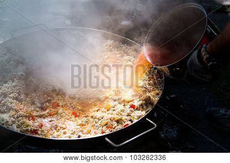 Preparing Paella With Broth