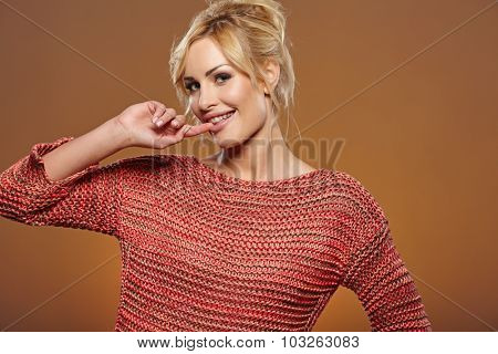 Beautiful blonde woman portrait in autumn color. Studio shoot