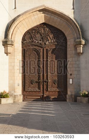 Carved wooden gate of the Hluboka Castle in Hluboka nad Vltavou, South Bohemia, Czech Republic.