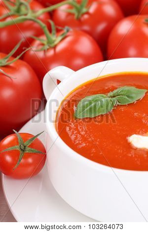 Tomato Soup With Tomatoes And Basil In Bowl