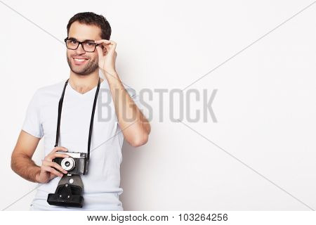 life style  and people concept: young man with a retro camera  on a white background