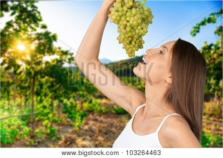 Eating Grapes.