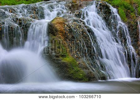 nice mountain stream on green stones