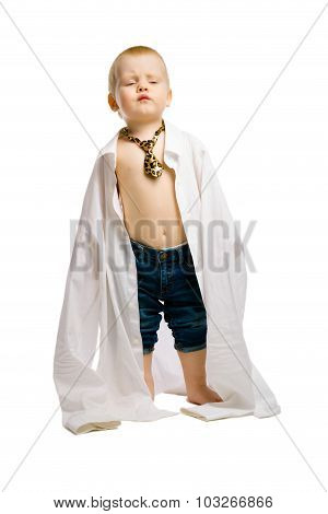 Baby Boy In A Huge Shirt And Tie. Studio