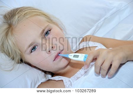 Sick Girl With Thermometer In Mouth Lying On Bed