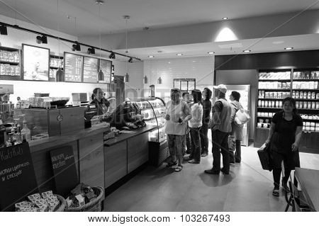 SAINT PETERSBURG, RUSSIA - JULY 08, 2015: Starbucks cafe interior. Starbucks Corporation is an American global coffee company and coffeehouse chain based in Seattle, Washington