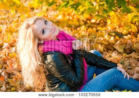 Pretty Girl Posing With Autumn Leaves In Park