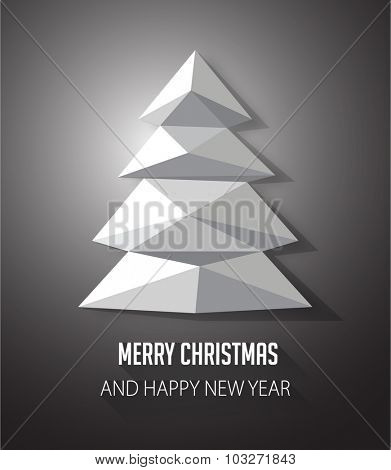 Christmas tree made with geometrical abstract triangle on black background