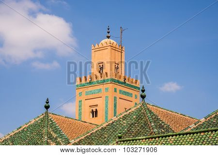 Mosque In Marrakech With A Green Roof In Front