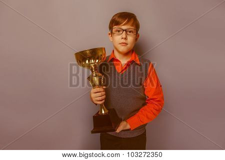 European-looking  boy of  ten years in glasses holding a cup, aw