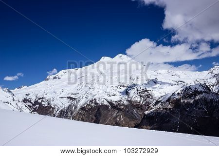 snowy on a background of two-headed Elbrus in the clouds