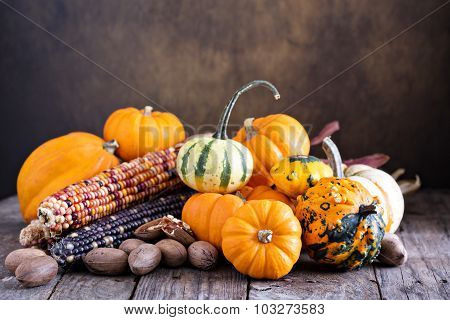 Pumpkins, indian corn and variety of squash