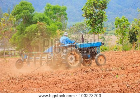 Blue Tractor Work On The Field