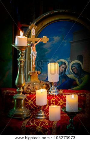 Artistic Vintage Vignette Edit Of An Old Altar With Dusty Wooden Crucifix And Burning White Candles