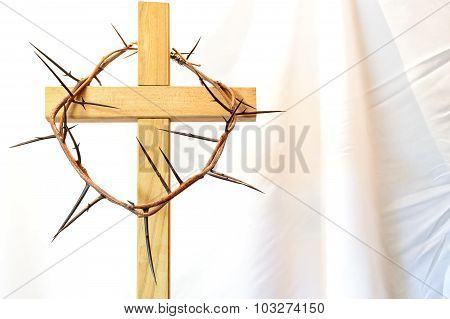 Wooden Cross With A Crown Of Thorns Lent Easter Resurrection Passion On A White Cloth Background