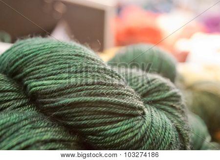 Green yarn twists in retail display