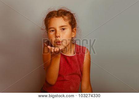 Girl European appearance decade  kiss on a blue background retro
