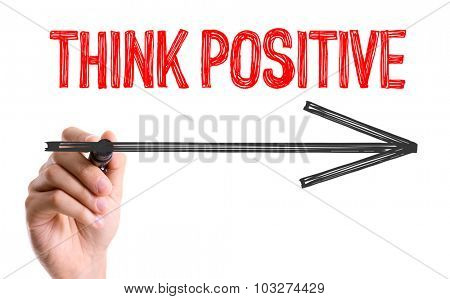 Hand with marker writing: Think Positive
