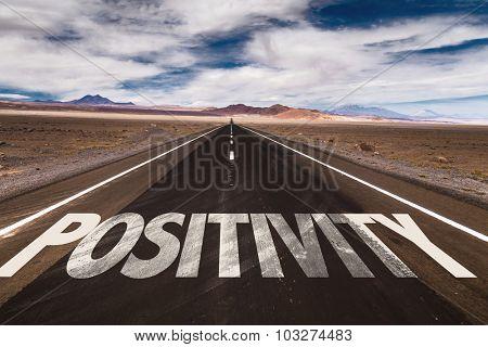 Positivity written on desert road