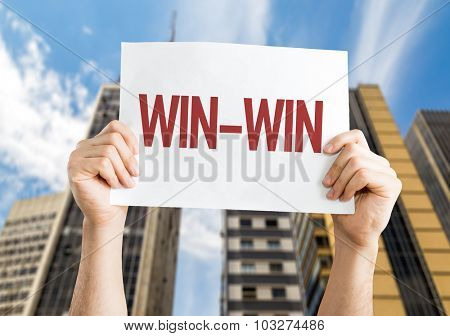 Win-Win placard with cityscape background