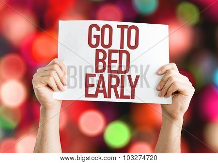 Go To Bed Early placard with bokeh background