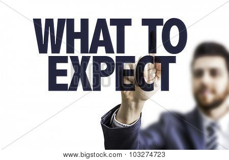 Business man pointing the text: What To Expect