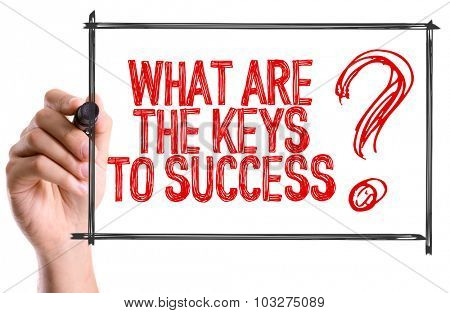 Hand with marker writing: What Are The Keys To Success?