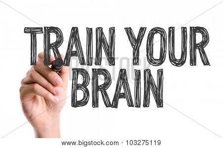 Hand with marker writing: Train Your Brain